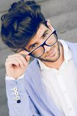 Cheerful Trendy Guy With Black Eyeglasses On