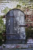picture of alcatraz  - Old wall with wooden door at Alcatraz Island Jail off San Francisco - JPG