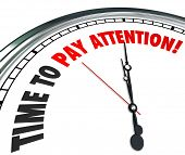picture of attention  - Time to Pay Attention words on a 3d clock face to illustrate importance of listening and hearing vital or urgent information - JPG