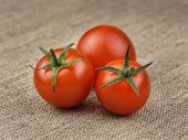 Ripe Fresh Cherry Tomatoes On Coarse Fabric