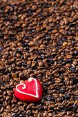 still life of coffee beans and marzipan heart