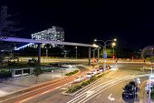 Broadbeach nightscape, G:link light rail zooming past traffic
