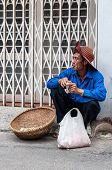 Peanut street vendor having a smoke