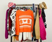 Cute sweaters displayed on a rack.