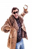 stock photo of snowball-fight  - a young man wearing a sheepskin coat isolated over a white background playing with a snowball - JPG