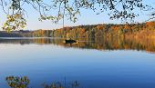 Tranquil Lake With Lonely Rowing Boat