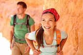 Hiking people - couple hikers in Bryce Canyon walking smiling happy together. Multiracial couple, yo