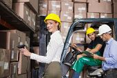 Warehouse team working during busy period in a large warehouse