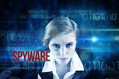 The word spyware and focused businesswoman against blue technology design with binary code