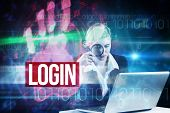 The word login and redhead businesswoman using her laptop against red technology hand print design