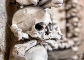 stock photo of catacombs  - Human skull in the basement vault lined one over the other - JPG
