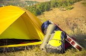 picture of tent  - camping yellow tent with a guitar on the hill - JPG
