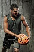 Afro-american man playing basketball