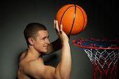 Basketball athlete throwing ball into the basket