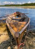image of dock a lake  - Old wooden rowing boat at lake beach - JPG