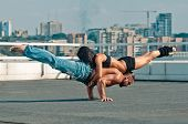 stock photo of gymnastic  - Couple yoga of woman and man on the house - JPG