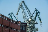 pic of polonia  - Shipyard cranes also called portal cranes in Gdansk Poland - JPG