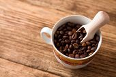 Upper View On Cup Full Of Coffee Grains