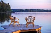 picture of dock a lake  - Two chairs on dock with glasses of wine - JPG