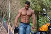 stock photo of muscle builder  - Biker Man Body builder And The Bike - JPG