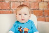 stock photo of little boys only  - portrait of a little boy in the room - JPG