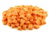 Sweet potato cubes on a white background