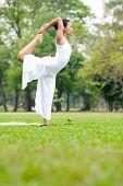 pic of natarajasana  - Beautiful woman practicing yoga in the park - JPG