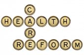 health care reform crossword in old round typewriter keys isolated on white