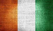 Ivory Coast flag on burlap fabric