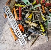 Pile of nails, screws, anchors and other building elements