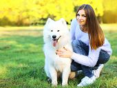 image of dog park  - Happy pretty woman owner and dog outdoors in the park - JPG