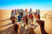 Landscape with people in the Sahara desert