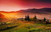 stock photo of asheville  - Sunrise in the mountain town of autumn morning in mountains Carpathians - JPG
