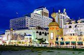 ATLANTIC CITY, NEW JERSEY - SEPTEMBER 8, 2012: Casinos line the Atlantic City boardwalk at dusk.