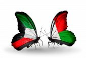 Two Butterflies With Flags On Wings As Symbol Of Relations Kuwait And Madagascar
