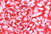 image of valentine candy  - pink and red candy corn bowl on candy corn for Valentine Day - JPG
