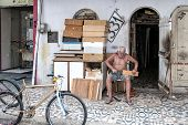 Elderly Man Working In The Street
