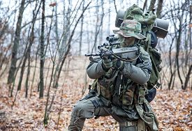 stock photo of raid  - Jagdkommando soldier Austrian special forces equipped with  assault rifle during the raid [[** Note: Shallow depth of field ** Note: Visible grain at 100%, best at smaller sizes - JPG