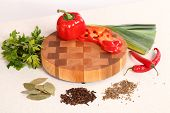 picture of leek  - red pepper cut on a chopping board a leek spices and parsley - JPG
