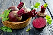 image of basil leaves  - Beets and Basil leaves on wooden table - JPG