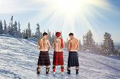 picture of peeing  - Three men peeing on the top of the mountain - JPG