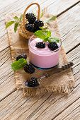 stock photo of blackberries  - Blackberry smoothie with berries in a basket on a rustic wooden table - JPG