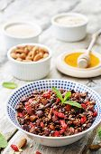 foto of quinoa  - oatmeal nuts quinoa granola on a dark wood background - JPG