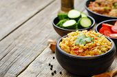 image of saffron  - saffron rice with vegetables and cilantro on a dark wood background - JPG
