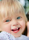 picture of rapture  - Happy and Cheerful Child in the Summer Park - JPG