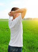 stock photo of rapture  - Happy Young Man at the Summer Field - JPG