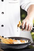 foto of pork  - Chef pouring shoyu sauce to the pan for cooking Japanese pork curry / cooking Japanese pork curry paste concept ** Note: Shallow depth of field - JPG