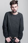 stock photo of pullovers  - Portrait of  young man in gray pullover - JPG