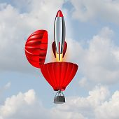 picture of acceleration  - Ambition concept and building momentum symbol of business success as a hot air balloon opening up with an emerging rocket ship blasting off for accelerated strategy to reach an objective - JPG