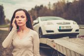 picture of towing  - Woman calling while tow truck picking up her car - JPG